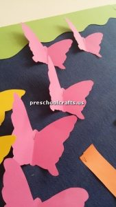 Make butterfly with colored paper bulletin board