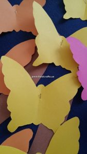 Make butterfly with colored paper for preschool
