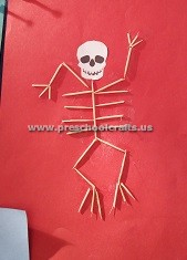 preschool-making-skeleton-with-ear-stick