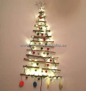 christmas tree with lamps and tree branch