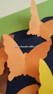 Make butterfly with colored paper for pre school