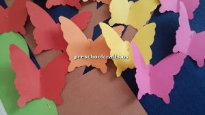 Make butterfly with colored paper for preschooler