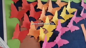 Make butterfly with colored paper for preschoolers